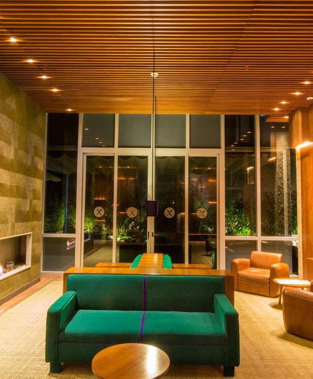 Sala de estar Bioxury Hotel Bogotá